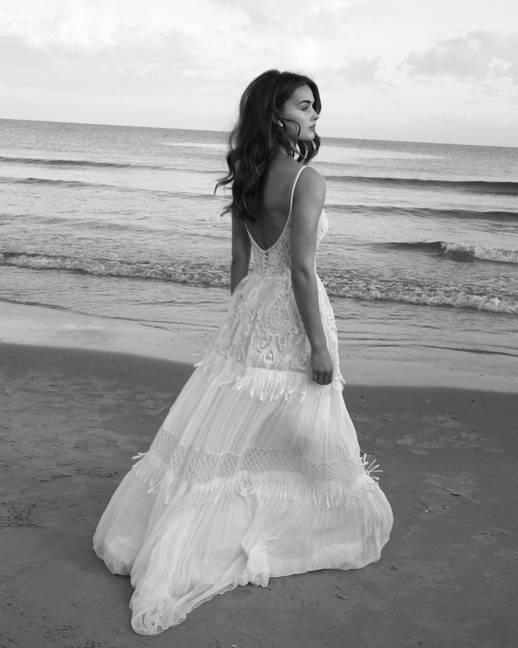 Scoop Neckline Boho Beach Wedding Dress with TasselsAn elegant freestyle beach wedding dress with tassels detailsThe dress is light weight and airy.Made to order, can be made with any changeFollow us ..