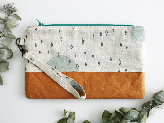 Washable paper clutch with teal geo pattern and removeable wristlet