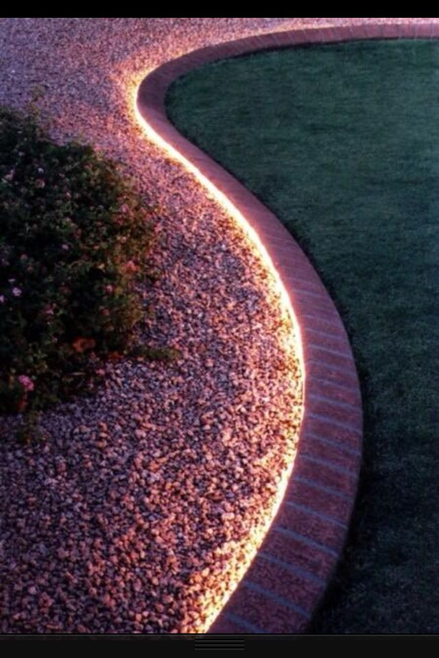 Love this lighting around the perimeter of the succulent sea garden.  Probably hidden rope lights.  Mix with up-lights to highlight some of the plants.  Genius!