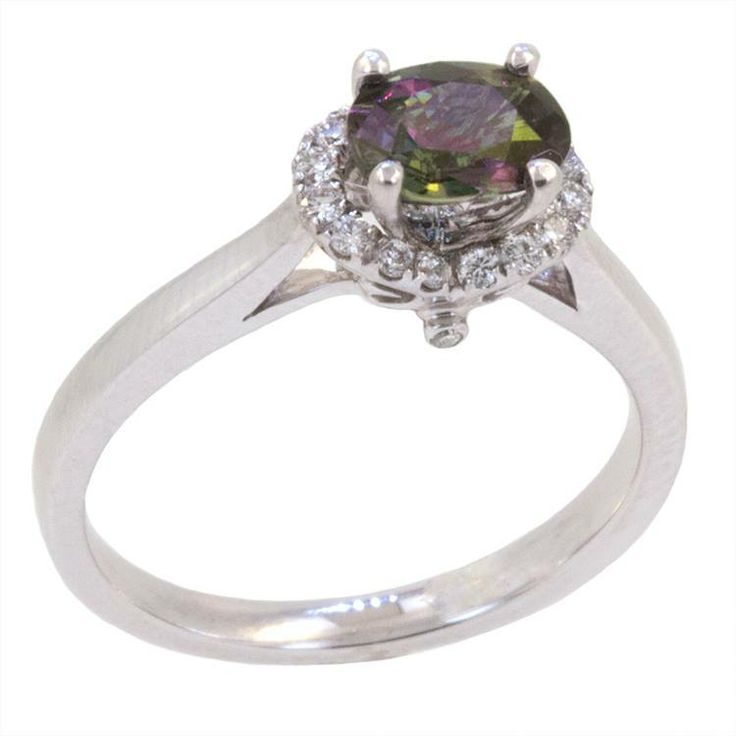 "Alexandrite is on of the rarest gems on earth. It is a ""colour-change"" gem and can display multiple colours at a time. The most common colour change in a natural alexandrite is green to purplish red. How cool is that? This ring is 18k wg with a 0.86ct Alexandrite in the center. It is surrounded by 0.14cts of diamonds."