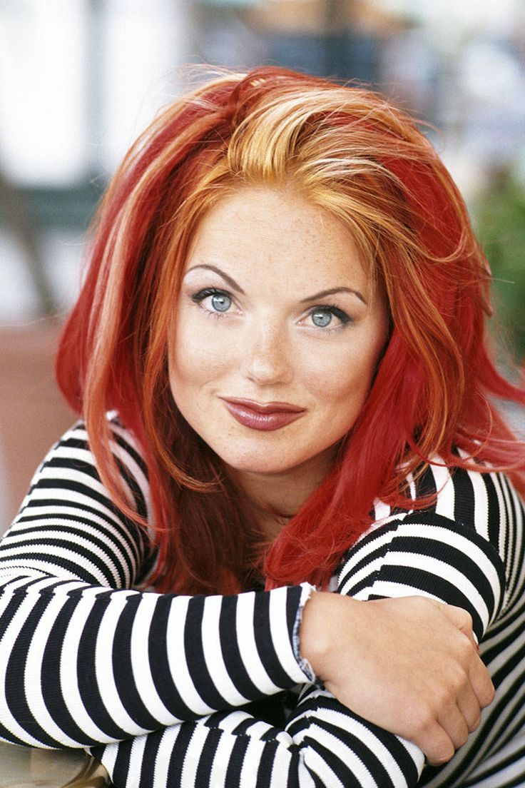 40 Iconic Redhead Celebrities - ELLE: Geri Halliwell / Ginger Spice of the Spice Girls, with her trademark blonde-streaked cherry-red locks. Since then, she's kept her color