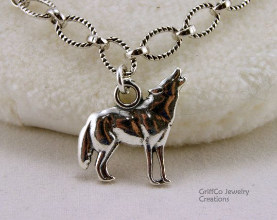 It's silver.... and a wolf.... and a bracelet. I think I must have it.