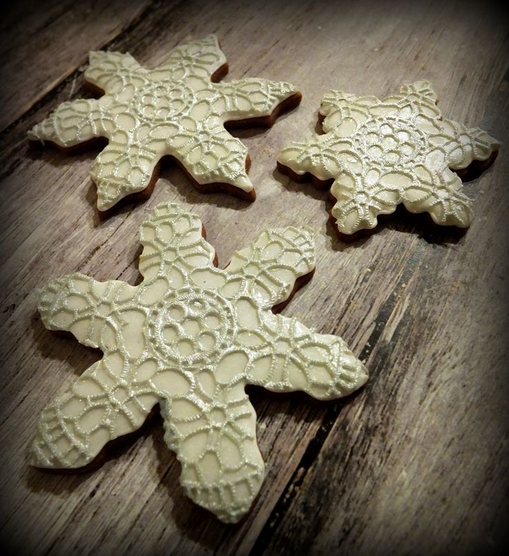 Christmas snowflake cookies decorated with silver edible lace