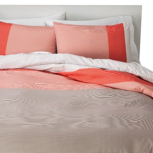 <p>Make your room your happy place with a Room Essentials Striped Colorblock Duvet Cover Set in Coral. Smartly finished with subtle stripes of varying hues and accented with vibrant blocks of color, this duvet set will instantly transform your room from drab to fab. Value-priced and available in standard mattress sizes, a Room Essentials duvet cover is a quick and affordable way to reinvent any room. Made of lightweight and breathable, cotton-blended fabric to keep you cool an...