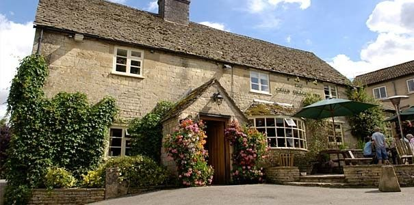 """The Green Dragon Inn has an idyllic location among fields, streams and farms in the hamlet of Cockleford. Dating from the 17th century, the Inn has become popular for good food, fine wine and real ales. The cosy and informal Mouse Bar or Lower Bar provide a wide range of excellent traditional and modern """"pub food with a difference"""". The bars and furniture have been hand crafted by the famous Robert Thompson - the """"Mouse Man of Kilburn""""."""
