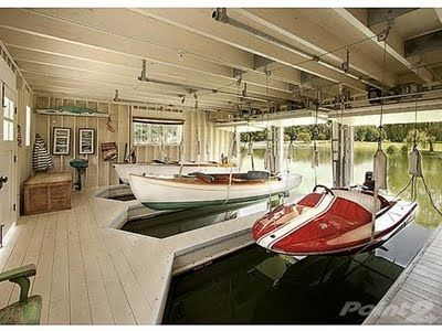 boat house, yesss. with a second story patio for jumping off of equipped with jet skiis and wakeboard boat with all the accessories :D