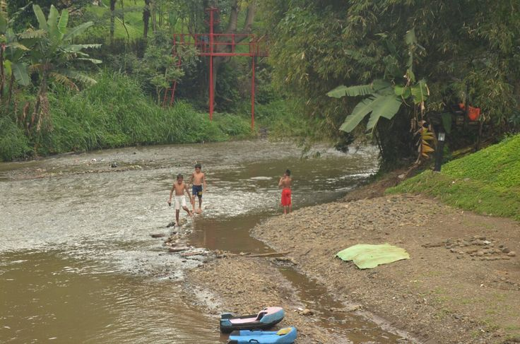 Children playing in the river Babakan siliwangi bandung