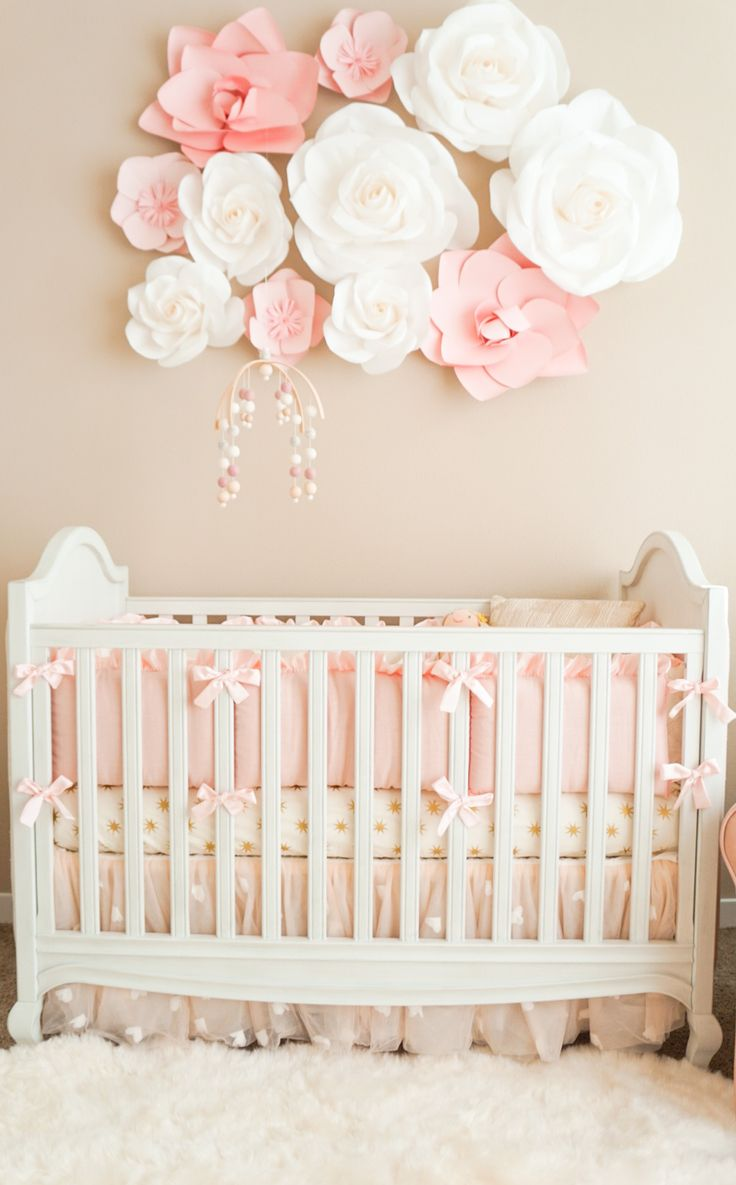 I'm so excited to finally share with you guys our baby girl's nursery! It has been a work in progress for a while now, and I started decorating pretty early on! I'm SO happy everything came together perfectly and it is finally complete