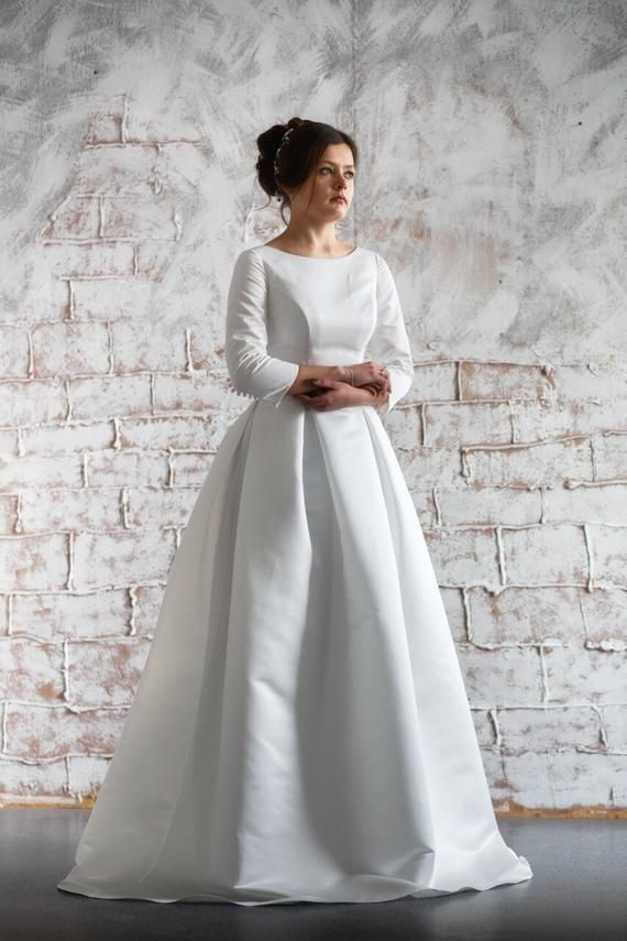 Classic Satin Wedding Dress Simple Design Is Relevant At Any Time And Any Country In The Wo With Images Satin Bridal Gowns Long Sleeve Bridal Gown Ball Gown Wedding Dress