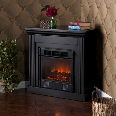 Convertible fireplaces can convert from standard for Small den with fireplace