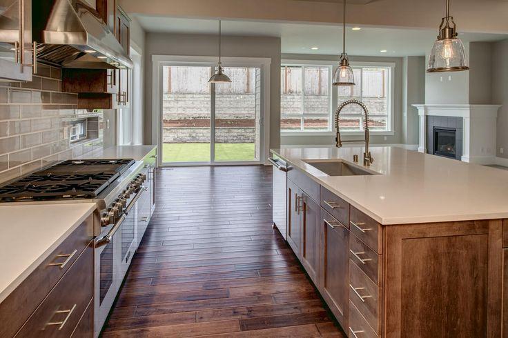 Astoria home plan kitchen. This open kitchen layout makes en