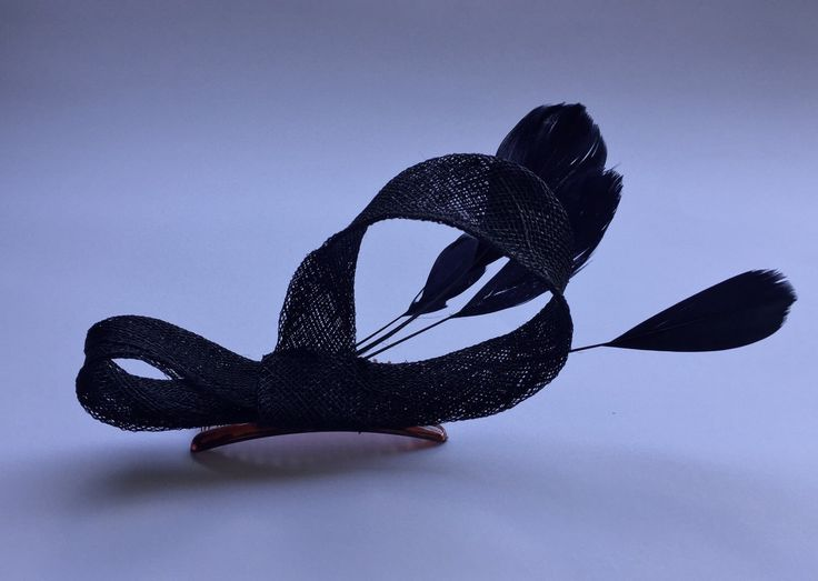 A personal favourite from my Etsy shop https://www.etsy.com/au/listing/252089462/black-fascinator-decorated-with-elegant