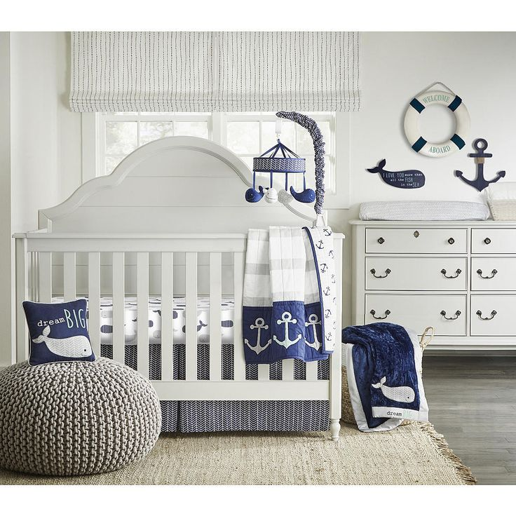 "Designer Wendy Bellissimo's on-trend take on nautical-themed bedding is fun and sophisticated. With a reversible (grey and white/aqua and white) quilt featuring anchor appliques on the fold-over, fitted crib sheet with an adorable print, chevron printed navy and white crib skirt, and a slipcovered navy throw pillow, appliqued and embroidered with a winsome whale and a reminder to ""Dream Big"", your little one will quickly sail away on a comfy voyage to Dreamland.<br>&..."