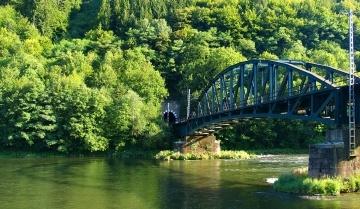 Summer view of railroad bridge and tunnel near Strecno village, Slovakia.