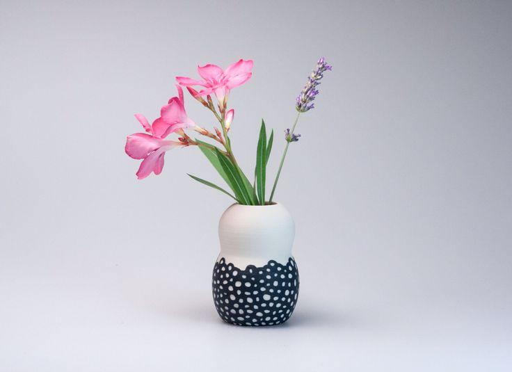 Small porcelain vase, handmade on the potter's wheel