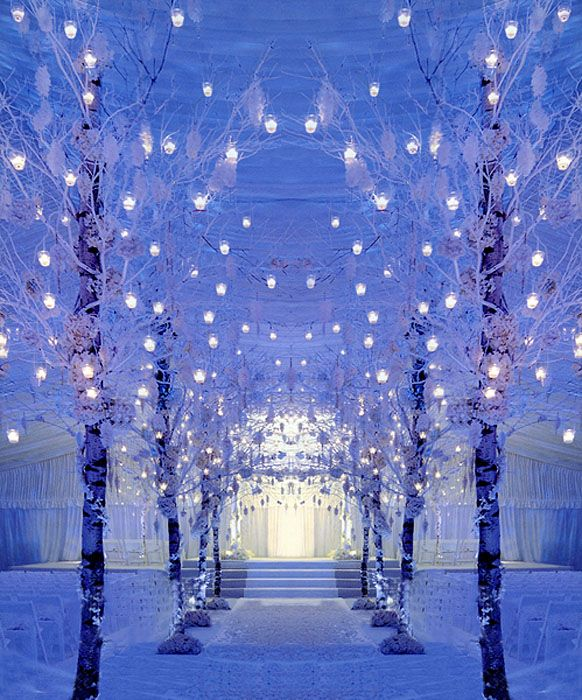 Beautiful Winter Wonderland Ceremony Décor. I want something similar to this. The colors are perfect, I wanted an all white ceremony look with a mixture of silver color, bling/sparkles, and glitter. Uplighting in Blue because its Todd's favorite color :)