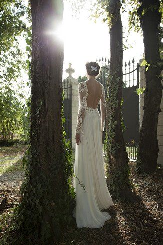 A flowing lace and chiffon @Roberta Causarano Cruz gown with a jaw-dropping open back.   See more here: Berta Bridal Couture 2014 Winter Collection   Confetti Daydreams ♥ ♥ ♥ LIKE US ON FB: www.facebook.com/confettidaydreams ♥ ♥ ♥ #Wedding #WeddingDress #WeddingGown