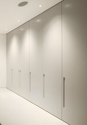floor to ceiling wardrobes (closets) inside the Villa Escarpa by Mario Martins Wardrobe door are a good choice SIMPLE