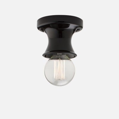Darkness falls. Here are 10 of our favorite black porch ceiling lights that keep a low profile (with either a flush or semi-flush mount) at prices from high to low, to cast a golden glow: