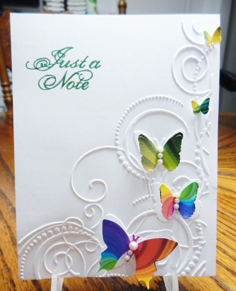 QFTD162 Jeanne's Reign - so clean and crisp!  I wish I knew what embossing folder and dp she used.- It is a Darice embossing folder 1216-64 called Butterflies in Corner and I found paper like the butterflies are cut from at Michaels.