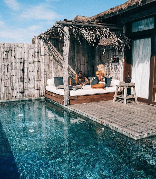 Sippin' fresh coconuts, poolside at our overwater villa @songsaacollective