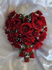 Heart shaped red rose bouquet: Valentine wedding?