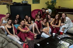 Members of the NOOA Dancers from Tel Mond, Israel relaxing before a performace during the Sister City visit to Sarasota Dec 5-10, 2012. Photo by Eric Hilton.
