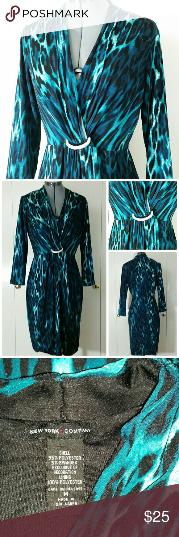 "NEW YORK &COMPANY Fake Wrap Dress NEW YORK & COMPANY Womens Sz. M Animal Print Dress  Gently used, minor flaw see last picture, overall still in good condition.  Measurements laying flat: Armpit to armpit: 17"" Waist: 14"" Length: 36.5"" Sleeve: 19""  Thanks,  Item#DD1 New York & Company Dresses"