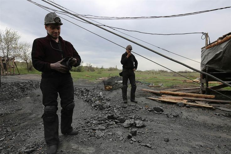 -Government- The two miners above are illegally mining in a no mining zone in Shahtersk, Ukraine. The miners are searching in an illegal pit for coal in an open field on a mining site. The fellow miners don't interfere with the illegal miners due to high-ranked security.