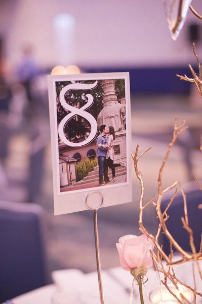 Engagement photos at the reception as part of the table decor