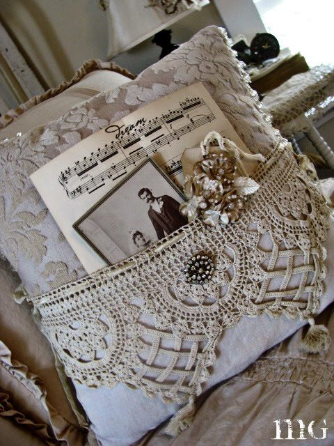 pocket pillows filled with pretty antiquities. what a beautiful gift idea!  my mind wanders to making sepia-toned copies of family photographs, printed sheet music of favorite hymns, etc.
