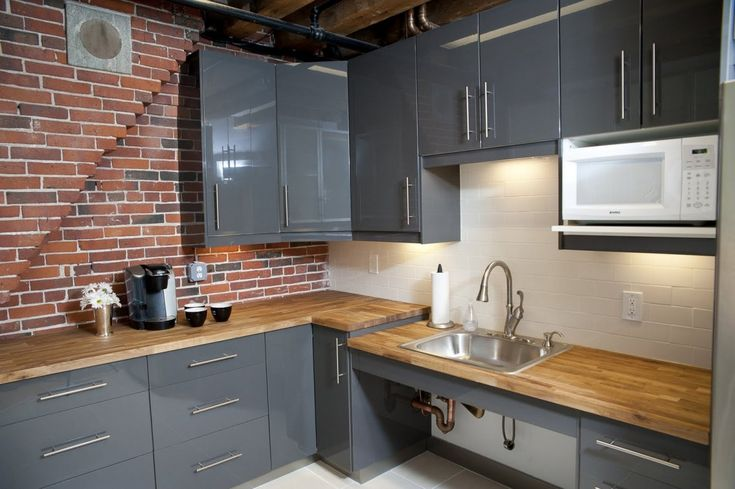 Classic Kitchen Area with Red Faux Brick Tile Backsplash Design, Glossy Dark Grey Kitchen Cabinet Ideas, and Single Handle Pull Down Faucet, 10 designs in Faux Brick Backsplash gallery