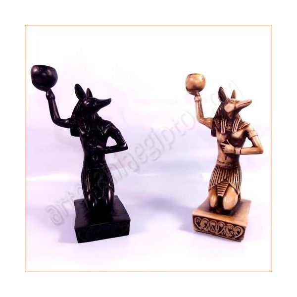 Figura de artesanía egipcia del dios Anubis, deidad encargada de transportar al espíritu de los difuntos hasta el otro mundo. La base y el busto están tallados en resina sólida, mezclada con piedra. Realizada artesanalmente y cuidadosamente detallada por los artesanos egipcios. Altura aproximada 18cm. www.artesaniaegipto.com