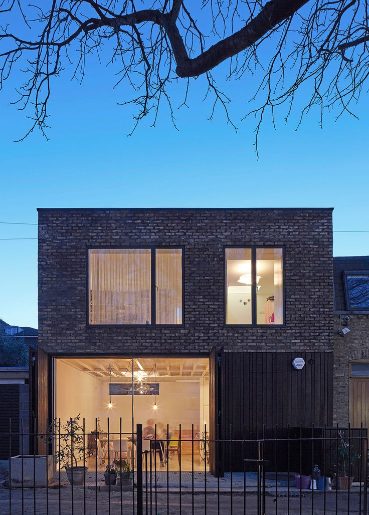 SAM Architects uses recycled brick and charred wood for London mews house