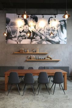 Modern dining room ideas | concrete wall, wooden dining table and a huge artwork selection | www.bocadolobo.com #diningroomdecorideas #moderndiningrooms
