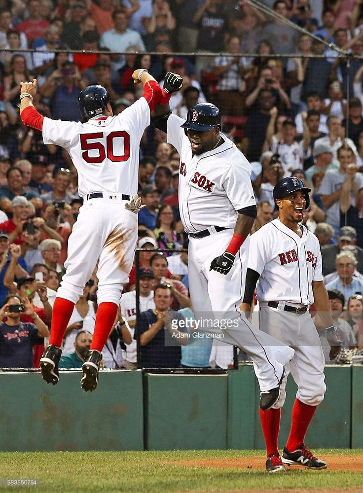 David Ortiz #34 high fives Mookie Betts #50 of the Boston Red Sox after hitting a three-run home run in the third inning during the game against the Detroit Tigers at Fenway Park on July 26, 2016 in Boston, Massachusetts.