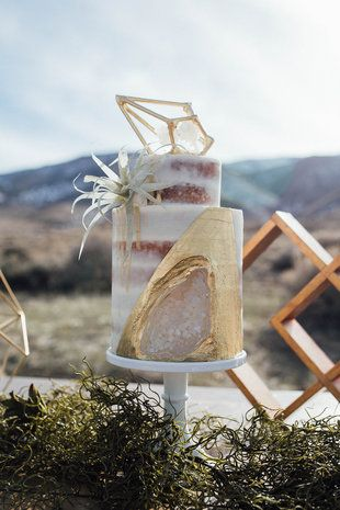 Modern naked wedding cake with gold details - two-tier semi-naked cake with gold geode detail + geometric cake topper {Emily Muench Photography}