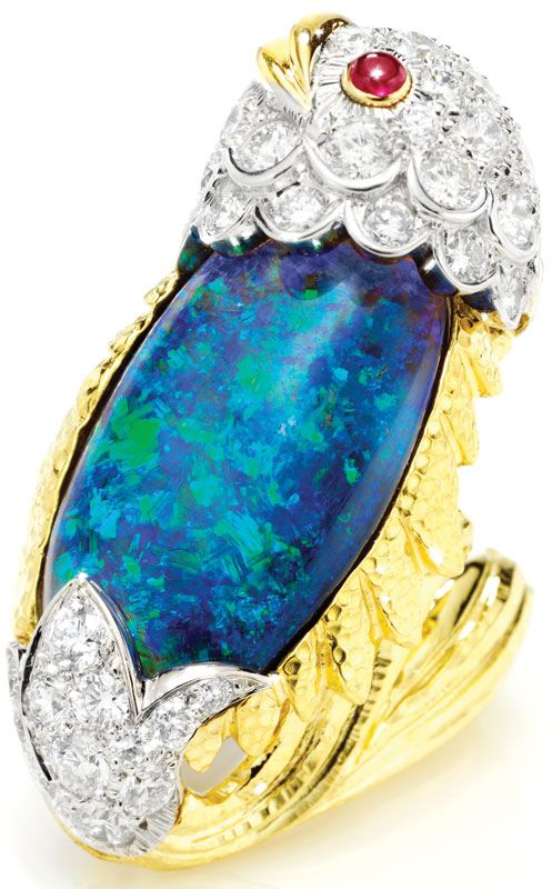This fish ring ($36,000) by David Webb features diamonds and rubies surrounding a center opal, all set in 18-karat gold and platinum. New York (212-421-3030,