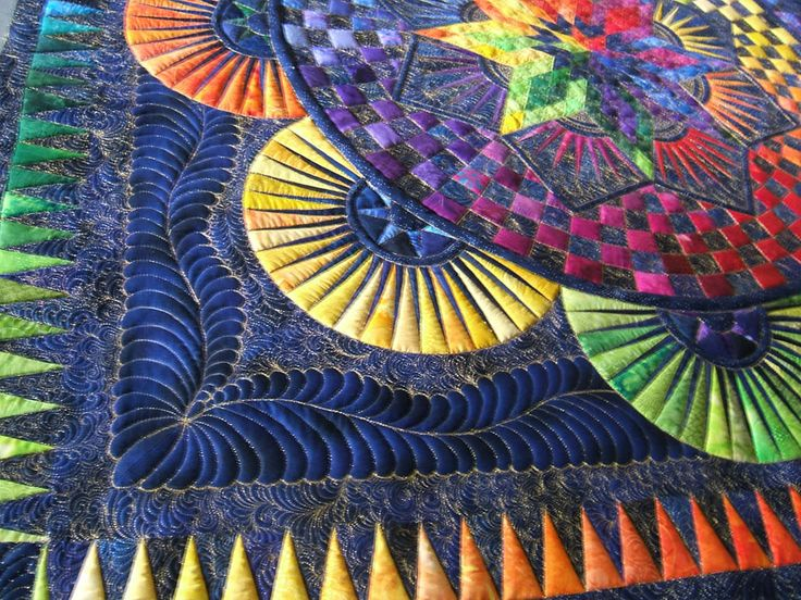 This is a Circle of Life quilt, one of Jacquline de Jonge ©BeColourful designs, stunningly quilted by Jamie Wallen is THE MASTER of longarm quilting.  All else pales by comparison!
