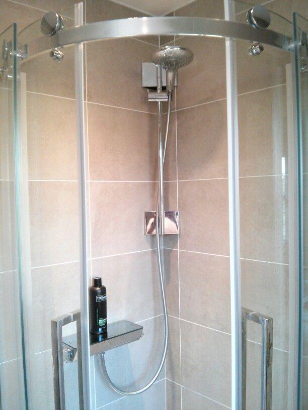 "Hansgrohe Raindance Select 150 in V8+ frameless quadrant shower enclosure. With ""Corner that Shower"" brackets."
