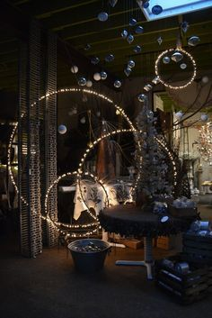 Spray paint hula hoops black, string lights on them and hang them from the ceiling at different heights #design