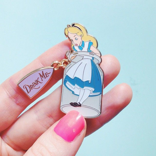 What a cute Alice in wonderland pin. What every disney lover needs