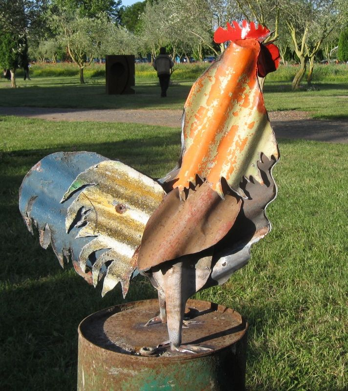 The Rooster sculpture is by Jeff Thomson, a New Zealand artist,  who sculpts with recycled corrugated roofing iron. The colour is the original roofing paints.