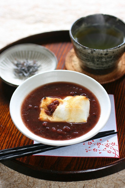 Zenzai (sweet azuki bean soup and grilled rice cake) by bananagranola (busy), via Flickr. | Azuki bean jam, water, a little salt, rice cake, shio-kombu (garnish).
