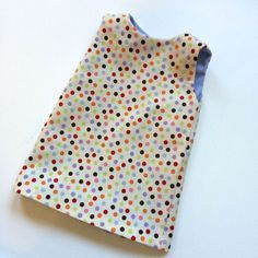 How to line a simple doll dress. Makes a sweet reversible dress.