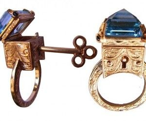 We came across this jewelry surprise. A unique ring with a large Topaz, the Topas hides a stash that can be opened with special key.