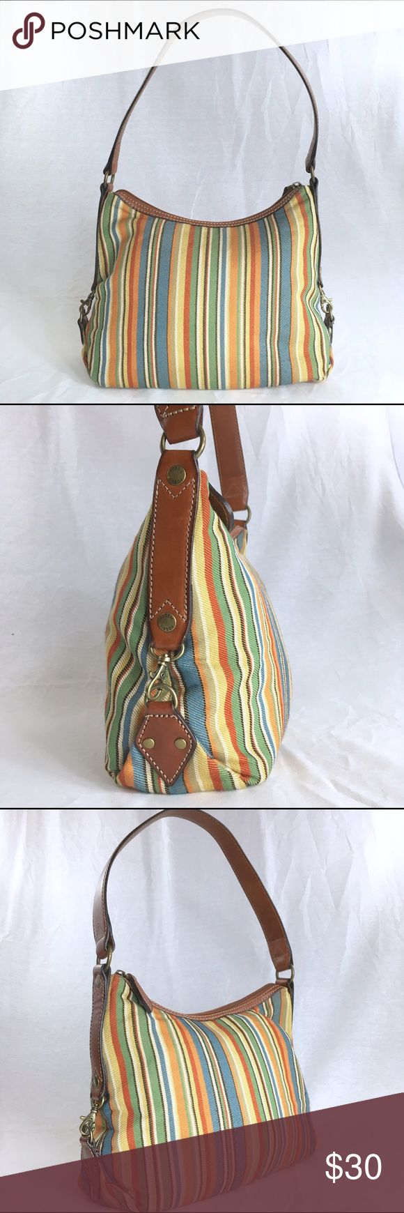 FOSSIL Striped Fabric Leather Trim Shoulder Hobo This vintage fossil bag is in very good condition. It has been very gently loved. The shoulder strap measures 21 inches. Fossil Bags Hobos