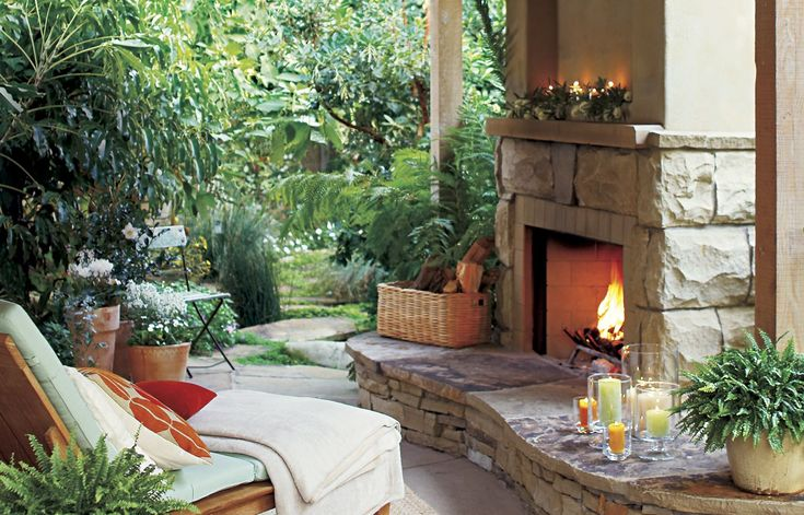 An open flame draws people near and keeps them cozy after the sun goes down. If you've got the space and budget for more than a fire pit, consider putting in a freestanding prefab fireplace and surrounding it with a hearth that doubles as a low sitting wall. For a DIY version of this wall with foot-traffic-friendly contours, construct a winding base of cinder block, face it with ledgestone veneer, and top it with custom-cut flagstone.  Similar to shown: San Juan prefab gas or propane fire...