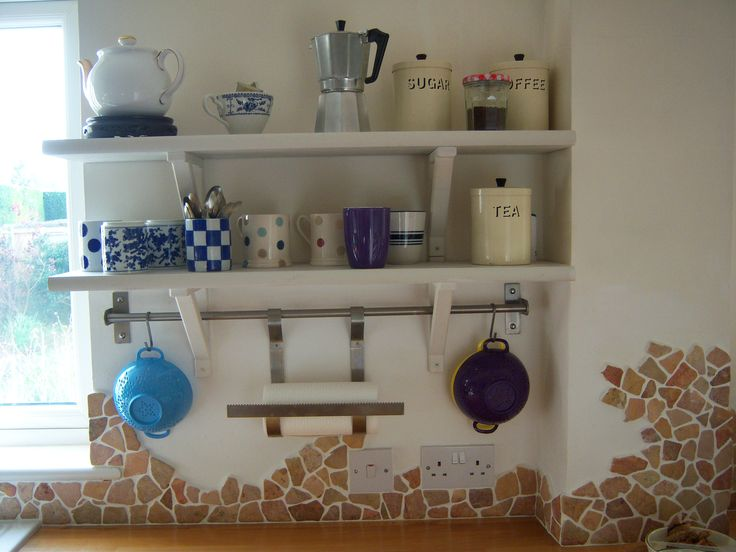Open shelves in my French-style country kitchen. Ikea brackets with MDF window sill cut to size gives them a nice curved front edge. Tumbled marble mosaic splashback covers rough wall where tiles were removed.