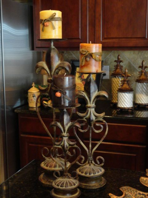 Love these fluer de lis candle holders & the canisters on back counter.